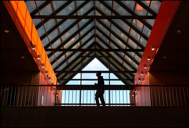 Squires Student Center with student silhouette.